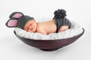 A newborn baby wearing a bunny costume